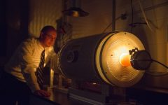 Space physicist David Miles is seen with a furnace that melts metal that is part of an important magnetic field instrument on Friday, May 3, 2019. The fluxgate magnetometer is used for measuring low-frequency magnetic fields during space missions.