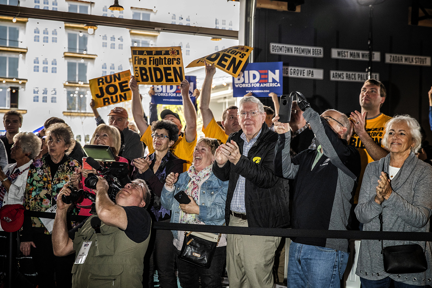 Attendees cheer for Former Vice President and 2020 Democratic Presidential candidate Joe Biden at Big Grove Brewery in Iowa City on Wednesday, May 1, 2019. Iowa City was the second stop on the Iowa Kickoff Tour for the Biden campaign.