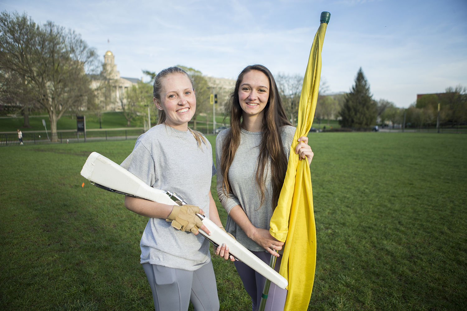 Color Guard Club Vice President, Haley Burton (left), and President, Joslyn Hagener, pose for a portrait at Hubbard Park on Monday, April 29, 2019. The new club will start classes and practices next fall for students of all experience levels to join.