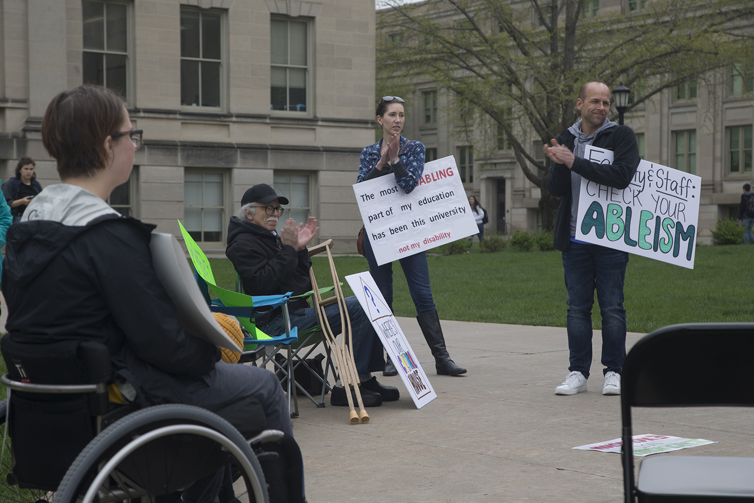Attendees clap after one of the volunteering speakers on the Pentacrest on Wednesday, May 1, 2019. UI Students for Disability Advocacy & Awareness organized this rally to speak about the injustice that students with disabilities face on campus.
