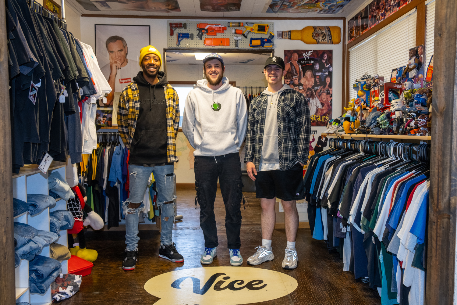 (From left) Demetrius Perry, Peter Krogull, and Tony Casella pose for a portrait at their store Vice in Iowa City on Wednesday, May 8, 2019. Vice sells streetwear and vintage clothing to the Iowa City community, and online through their e-Bay page. In April Perry, Krogull, and Casella started a podcast about sneakers, fashion, and the fashion culture of Iowa City.