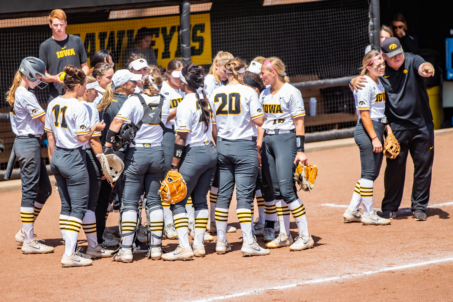 Iowa players huddle between innings during a softball game between Iowa and Ohio State at Bob Pearl Field on Sunday, May 5, 2019. The Hawkeyes, celebrating senior day, fell to the Buckeyes, 5-0.