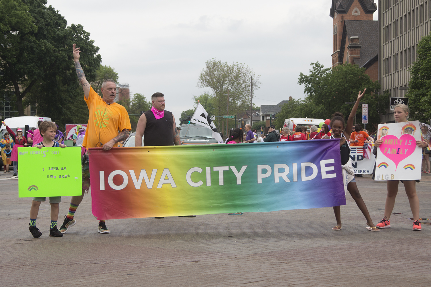 Paul and Chad Clark prepare to lead the Iowa City Pride parade as a family at Iowa City Pride on Saturday, June 15, 2019.