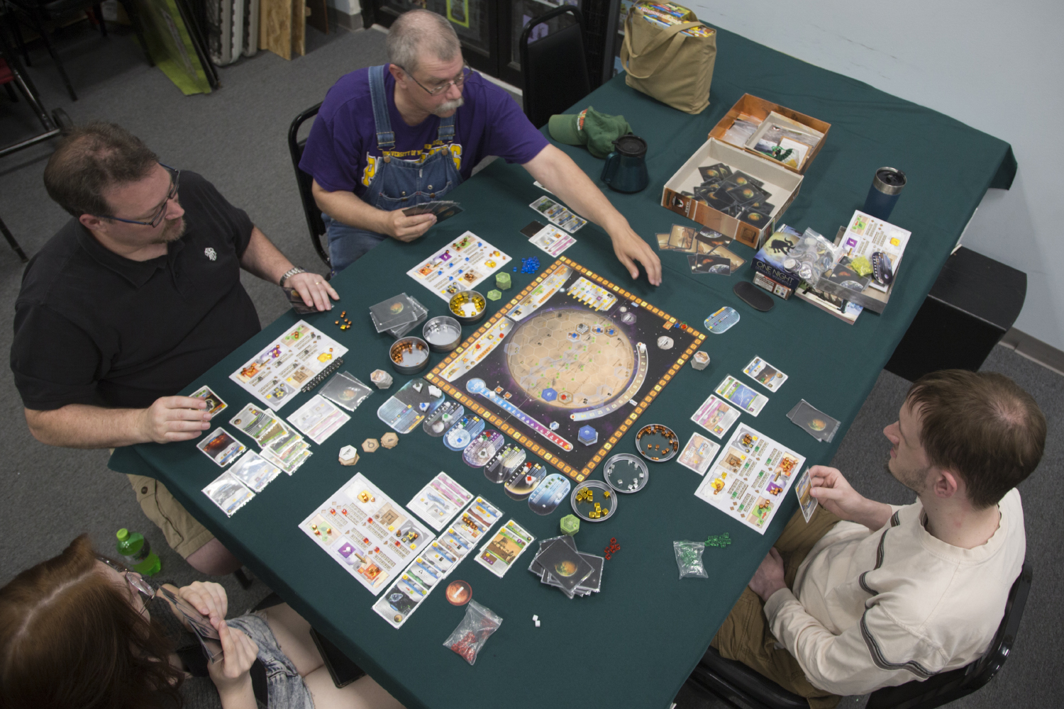 Board game club attendees play a game at Hobby Corner located in the Sycamore Mall on Thursday, June 6, 2019. (Emily Wangen/The Daily Iowan)