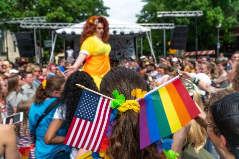 A crowd member watches the royalty show in Iowa City during the pride weekend on June 15, 2019.
