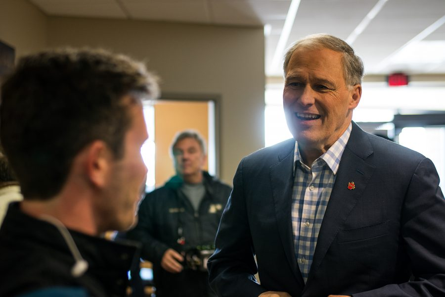 Washigton Governor Jay Inslee stopped by Paulson Electric Co in Cedar Rapids on Tuesday March 5, 2019. Jay Inslee talked with CEO Tyler Olson about climate change and how solar pannels combat its effects. (Roman Slabach/The Daily Iowan).