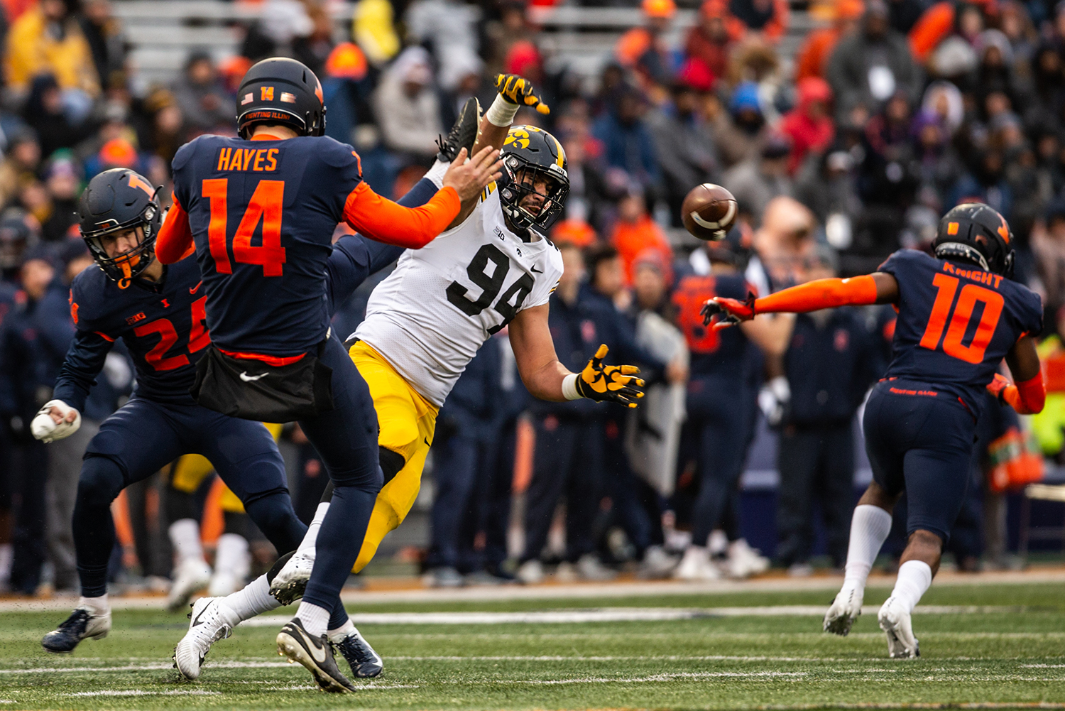Iowa defensive lineman A.J. Epenesa blocks a punt during Iowa's game against Illinois at Memorial Stadium in Champaign on Saturday, Nov. 17, 2018. The Hawkeyes defeated the Fighting Illini 63-0.