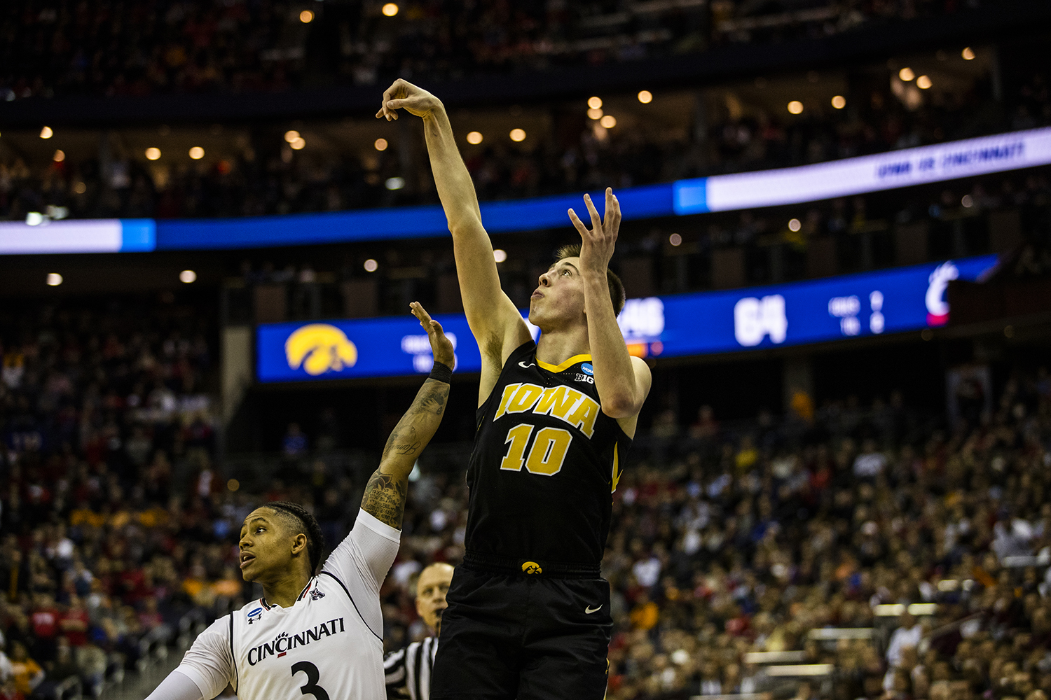 Iowa guard Joe Wieskamp shoots a three-pointer in the last couple minutes of the NCAA game against Cincinnati at Nationwide Arena on Friday, March 22, 2019. The Hawkeyes defeated the Bearcats 79-72.