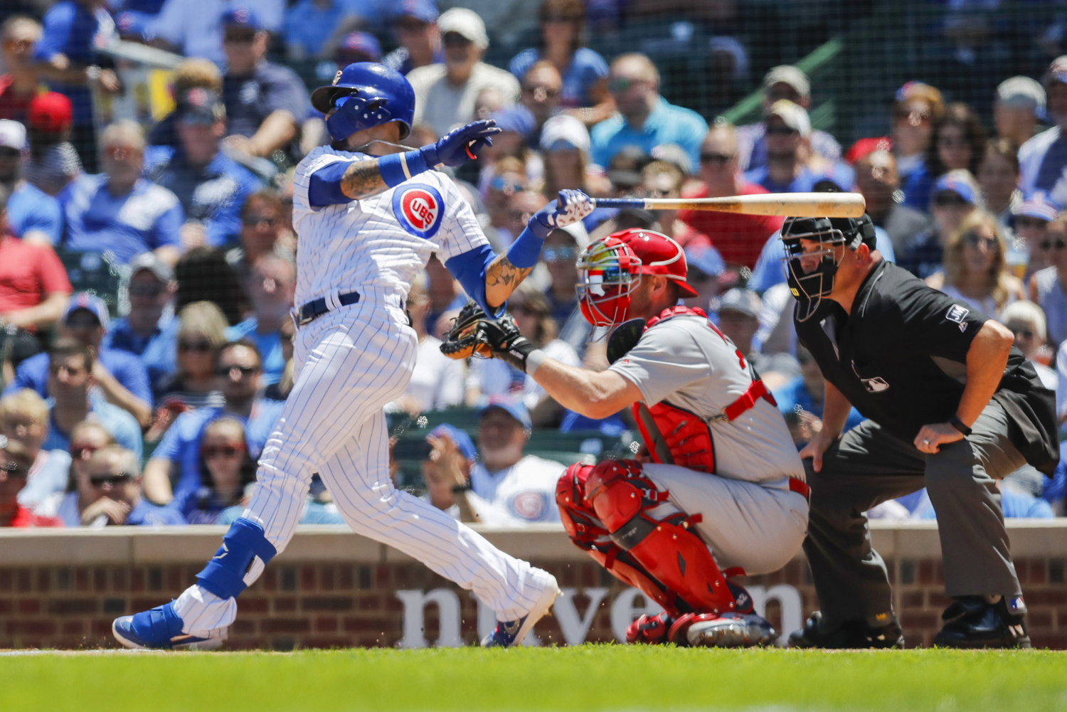 The Chicago Cubs' Javier Baez hits a two-run home run in first the inning against the St. Louis Cardinals at Wrigley Field in Chicago on Friday, June 7, 2019. The Cubs won, 3-1. (Jose M. Osorio/Chicago Tribune/TNS)