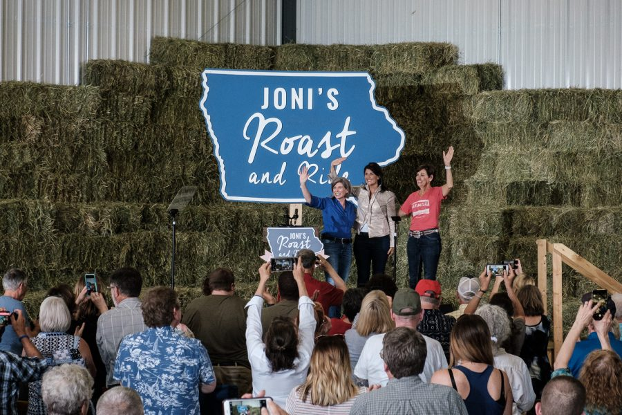 Sen. Joni Ernst, R-Iowa, waves to an audience with special guests former United States Ambassador Nikki Haley and Iowa Governor Kim Reynolds, concluding her annual Roast and Ride event in Boone, Iowa on Saturday, June 15, 2019. (Wyatt Dlouhy/The Daily Iowan)
