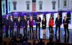 From left, Democratic presidential candidates New York City Mayor Bill De Blasio, Rep. Tim Ryan (D-Ohio), former housing secretary Julian Castro, Sen. Cory Booker (D-N.J.), Sen. Elizabeth Warren (D-Mass.), former Texas congressman Beto O'Rourke, Sen. Amy Klobuchar (D-Minn.), Rep. Tulsi Gabbard (D-Hawaii), Washington Gov. Jay Inslee, and former Maryland congressman John Delaney take the stage during the first night of the Democratic presidential debate on Wednesday, June 26, 2019, in Miami. (Joe Raedle/Getty Images/TNS) **FOR USE WITH THIS STORY ONLY**