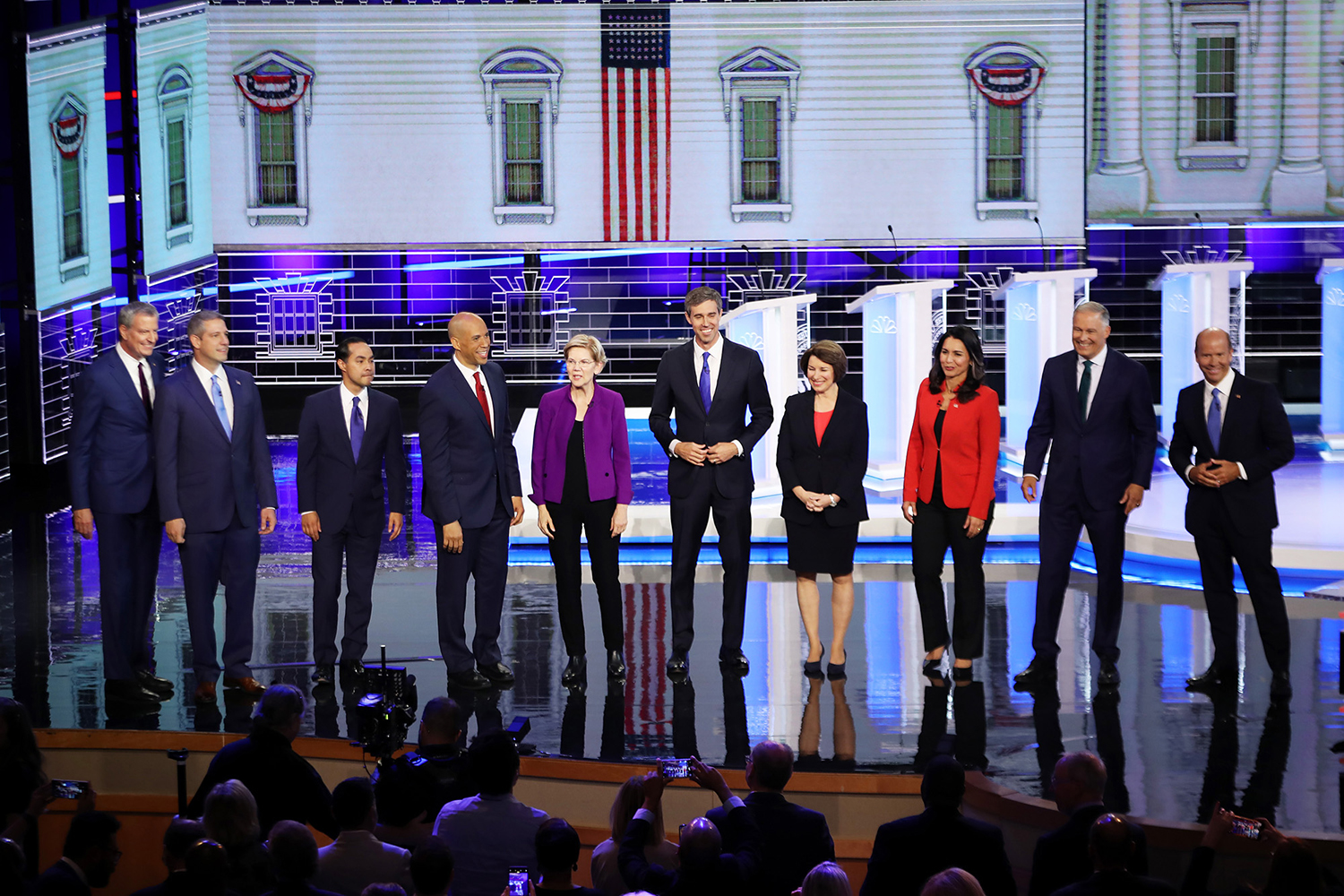 From left, Democratic presidential candidates New York City Mayor Bill De Blasio, Rep. Tim Ryan (D-Ohio), former housing secretary Julian Castro, Sen. Cory Booker (D-N.J.), Sen. Elizabeth Warren (D-Mass.), former Texas congressman Beto O'Rourke, Sen. Amy Klobuchar (D-Minn.), Rep. Tulsi Gabbard (D-Hawaii), Washington Gov. Jay Inslee, and former Maryland congressman John Delaney take the stage during the first night of the Democratic presidential debate on Wednesday, June 26, 2019, in Miami. (Joe Raedle/Getty Images/TNS) **FOR USE WITH THIS STORY ONLY**