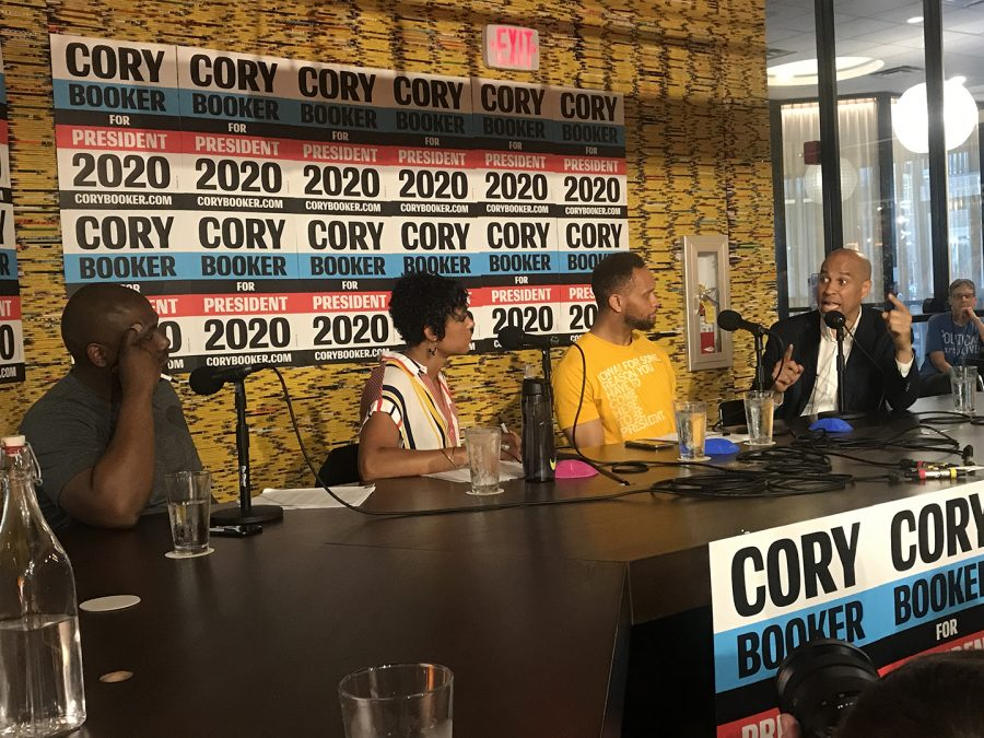 Sen.+Cory+Booker%2C+D-NJ%2C+appears+on+a+Political+Party+Live+podcast+in+Iowa+City+on+Saturday%2C+June+8%2C+at+the+Graduate+hotel.