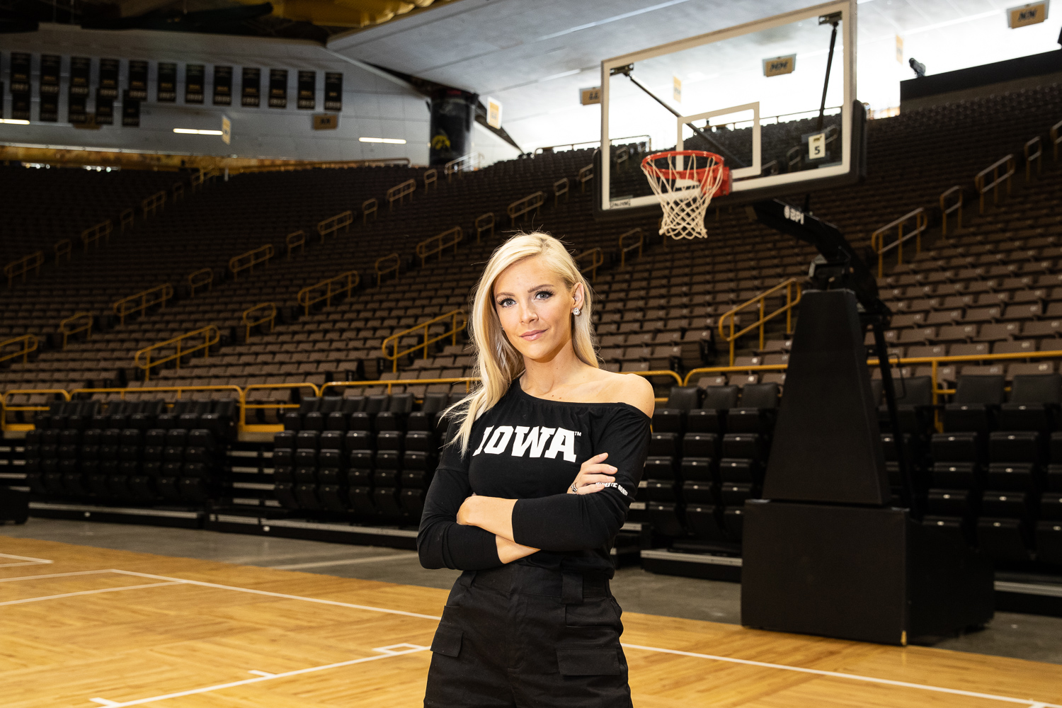 Hawkeye Sports host Laura Vandeberg poses for a portrait in Carver Hawkeye Arena on Thursday, June 13, 2019. (Wyatt Dlouhy/The Daily Iowan)