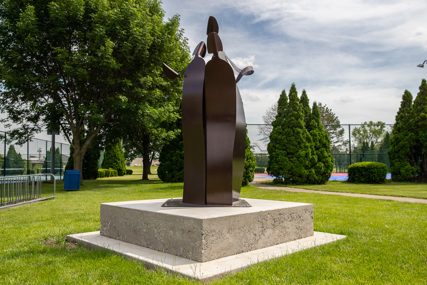 A statue dedicated to University of Iowa student Mollie Tibbetts is seen at Ahrens Park in Grinnell, Iowa on Thursday, June 6, 2019. Tibbetts died last summer. The statue created by Dubuque artist Gail Chavenelle was installed on May 18, 2019. (Wyatt Dlouhy/The Daily Iowan)