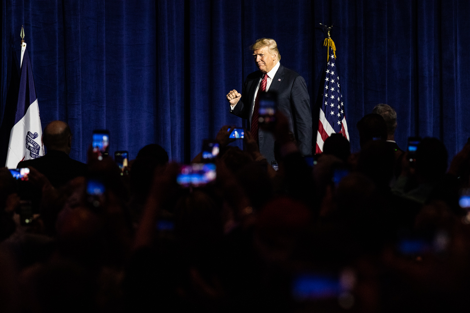 President Donald Trump walks to the podium during the Iowa GOP's America First Dinner at the Ron Pearson Center in West Des Moines on Tuesday, June 11, 2019. (Wyatt Dlouhy/The Daily Iowan)