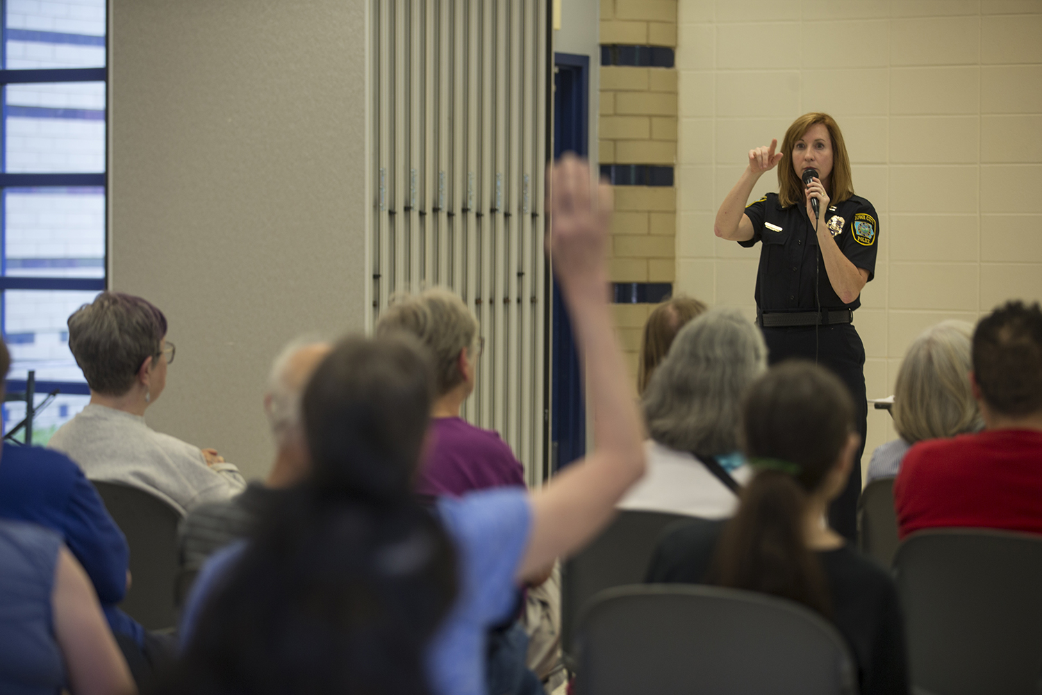 Iowa City Police Captain Denise Brotherton addresses the audience during a community meeting on the shooting at Mercer Park Aquatic Center on June 17, 2019. Police answered questions on community safety and police measures. (Katie Goodale/The Daily Iowan)