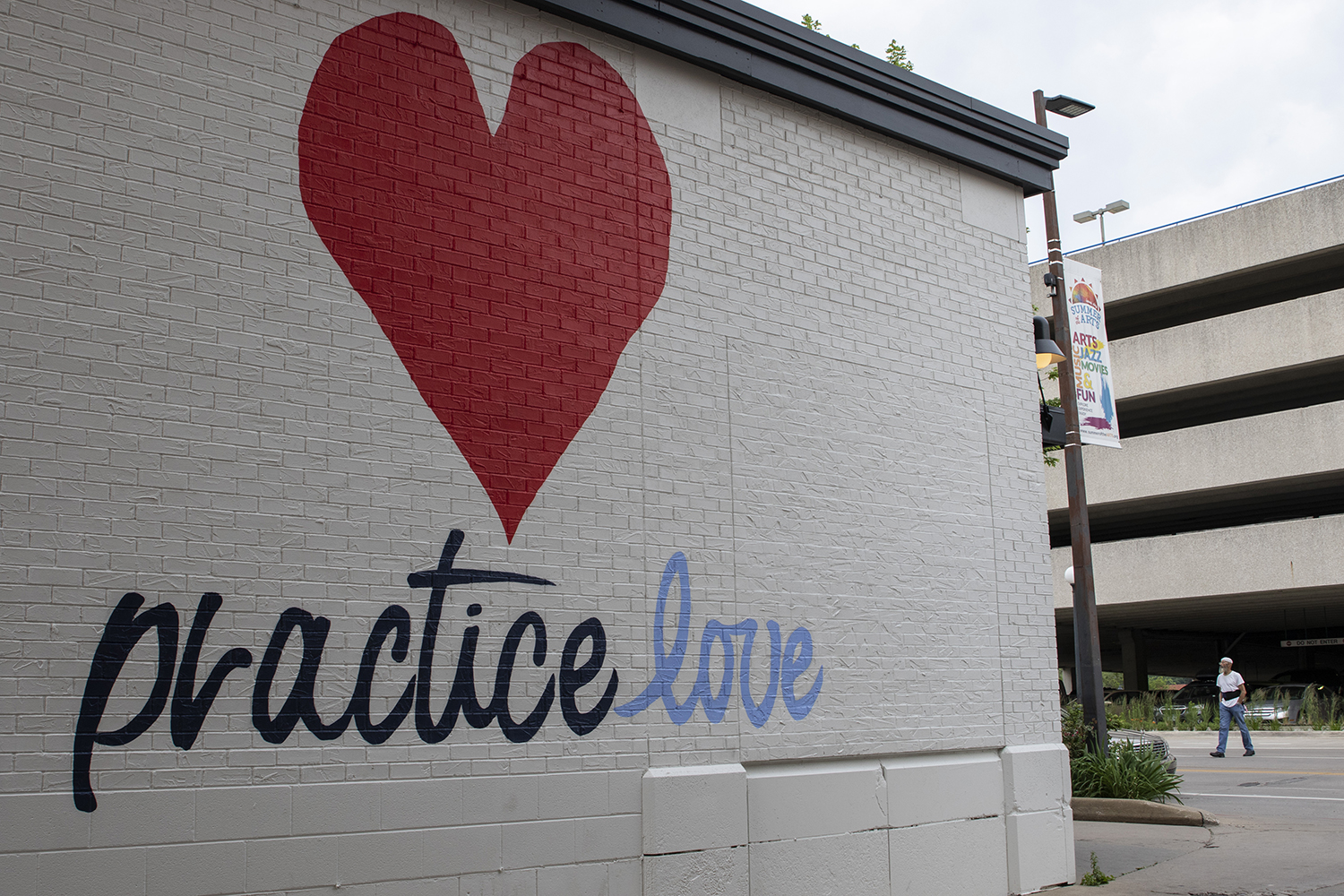 A new mural is seen on the side of Hothouse Yoga on June 22, 2019. (Katie Goodale/The Daily Iowan)