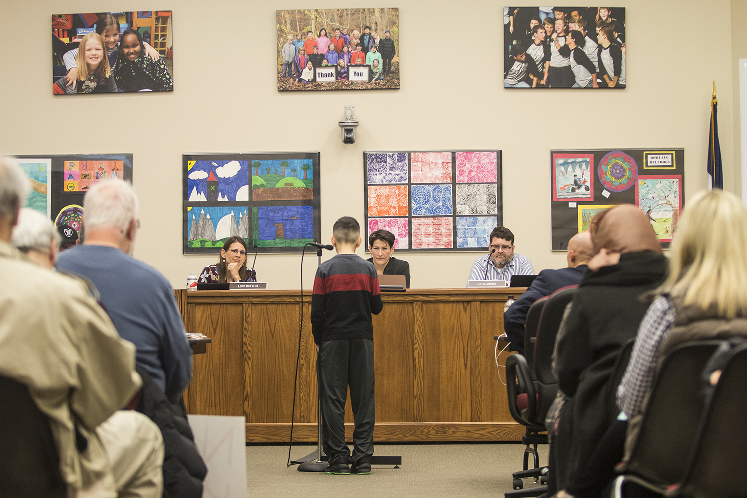 A young attendee speaks to the school board during an Iowa City school board meeting at the Professional Development Center on March 27, 2018. (Katina Zentz/The Daily Iowan)