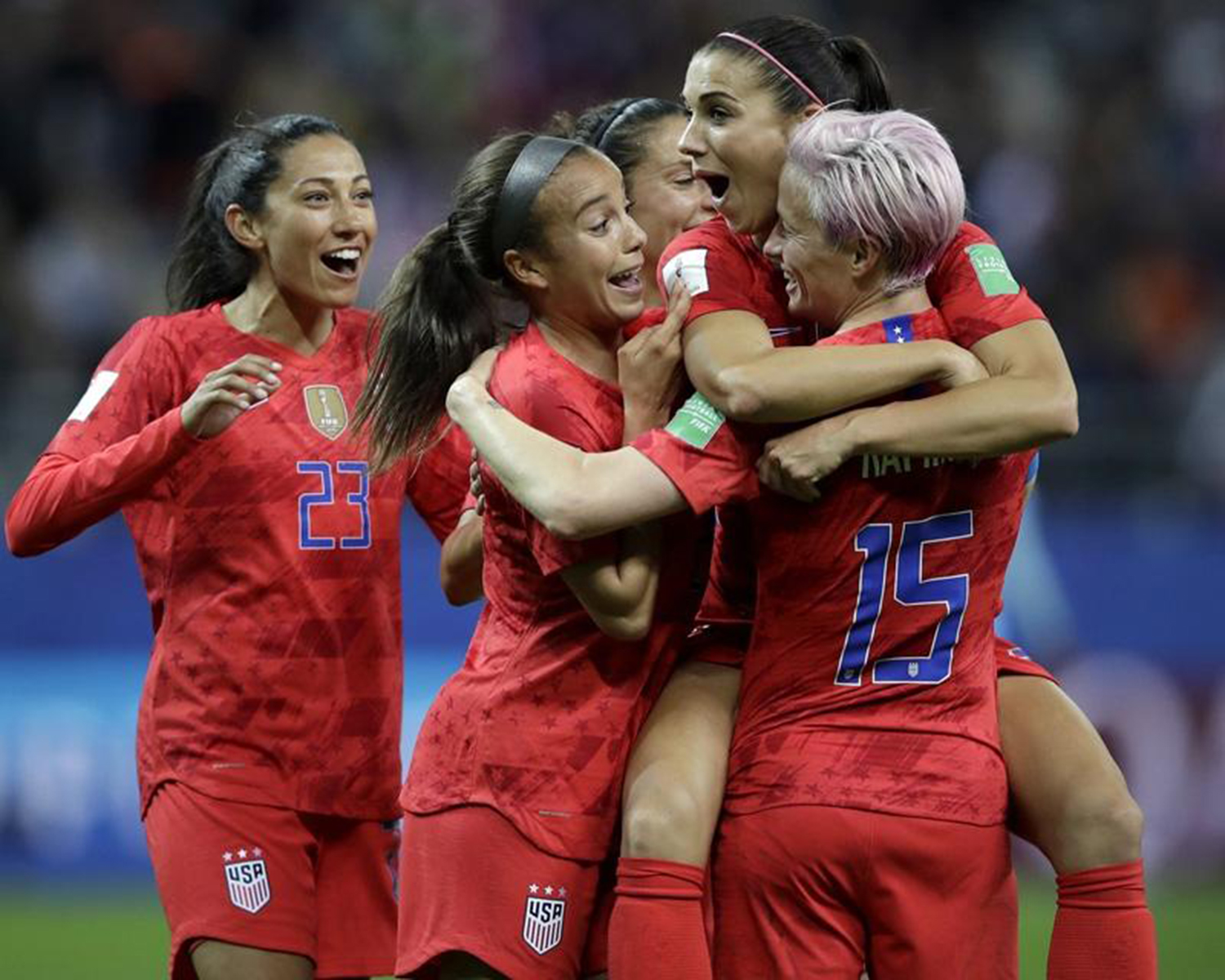 "Alex Morgan of the United States celebrates with teammates after scoring her fifth goal in Tuesday's 13-0 win over Thailand in the Women's World Cup Group F soccer match in Reims, France.  Volkswagen's new ""Inspire'' spot features  Morgan, a living embodiment of ""Drive Bigger'' for how she uses her platform to look out for the next generation of players and give back to the community. [ALESSANDRA TARANTINO]"