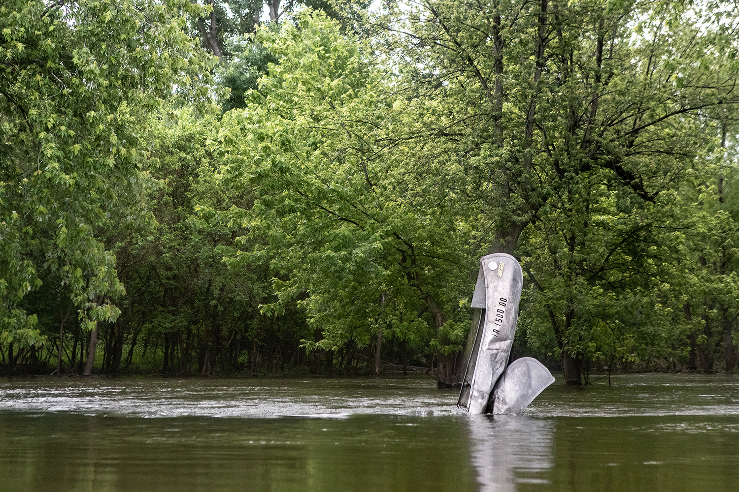 A+crumpled+canoe+sits+upright+in+the+waters+of+the+Iowa+River+south+of+Iowa+City+on+June+12%2C+2019.+The+Iowa+River+United+States+Geological+Survey+gauge+captured+a+flow+of+10%2C800+cubic+feet+per+second+on+June+15.