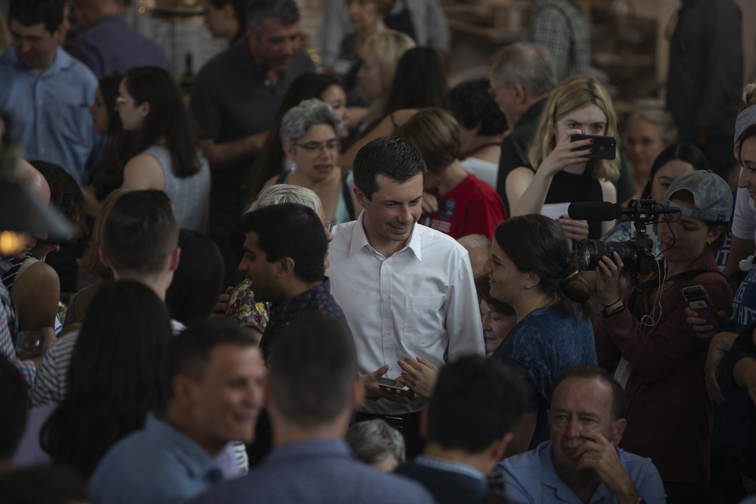 Mayor of South Bend, Indiana Pete Buttigieg talks with voters during a brunch fundraiser for Sen. Zach Wahls at the Walker Homestead on July 14, 2019.