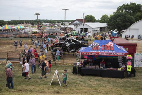 Fans gather to meet monster truck drivers during the first-evert All-Star Monster Trucks show at the Johnson County Fair on July 21, 2019.