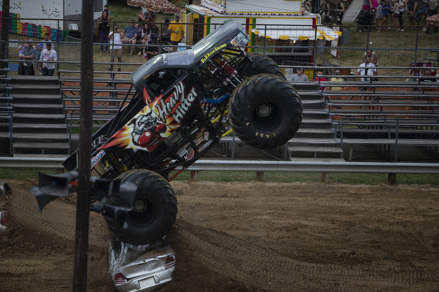 Heavy Hitter jumps over a car during the first-evert All-Star Monster Trucks show at the Johnson County Fair on July 21, 2019.