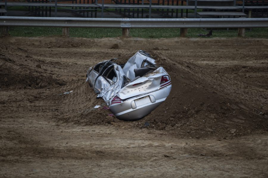A broken car is seen during the first-evert All-Star Monster Trucks show at the Johnson County Fair on July 21, 2019.