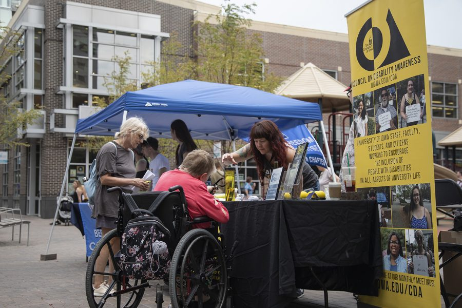 People gather during the 29th Celebration of the Americans of Disabilities Act at Ped Mall in Iowa City on July 27, 2019. (Tian Liu/The Daily Iowan)