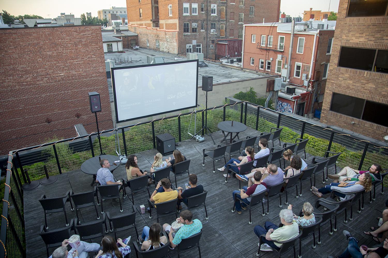 Moviegoers wait for a screening of La La Land to begin on the rooftop of Filmscene on Sunday, July 7, 2019. (Emily Wangen/The Daily Iowan)