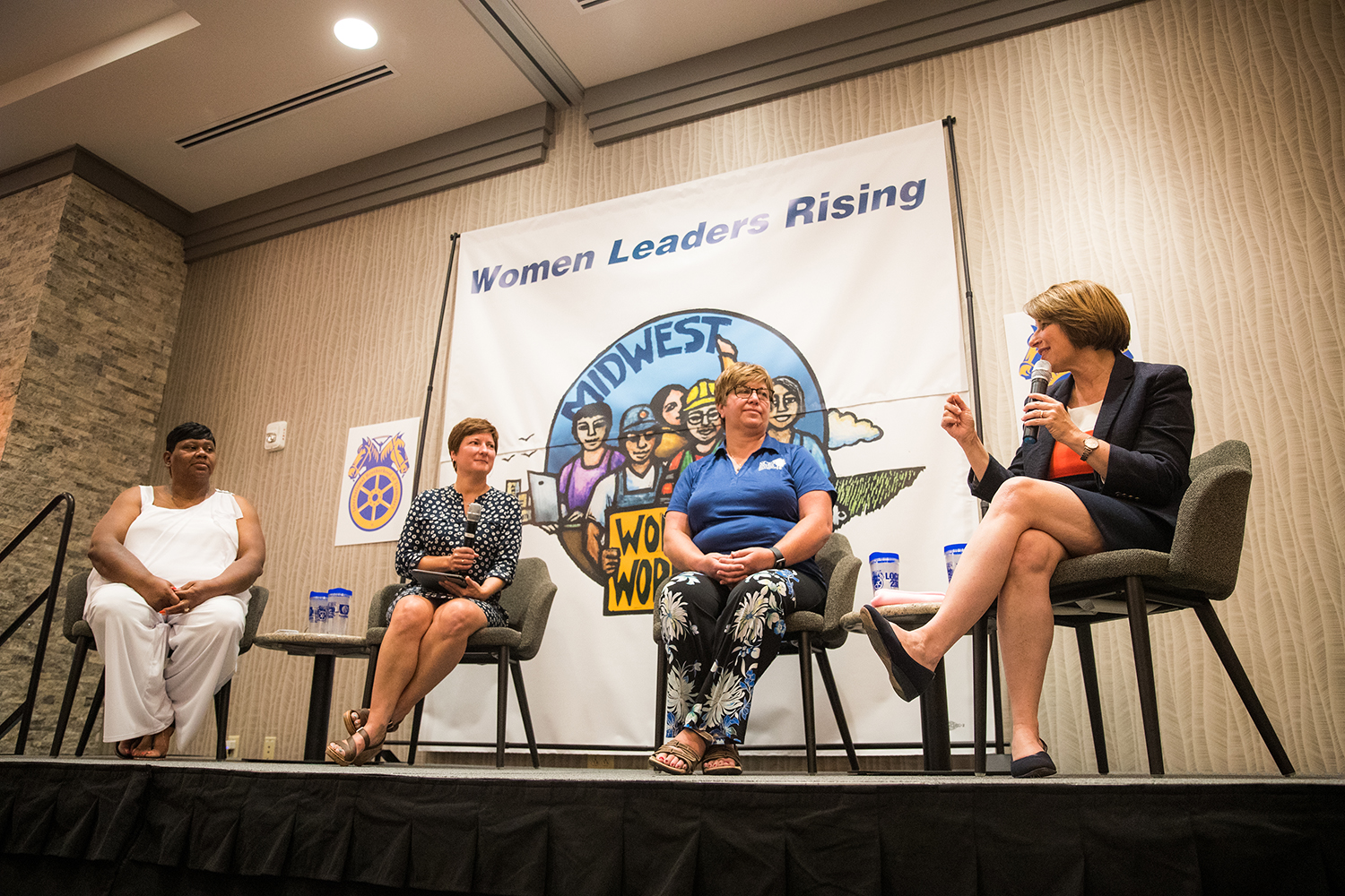 Sen. Amy Klobuchar, D-M.N., addresses members during the 2019 Midwest School for Woman Workers at The Hilton Garden Inn in Iowa City on Thursday July 25, 2019.