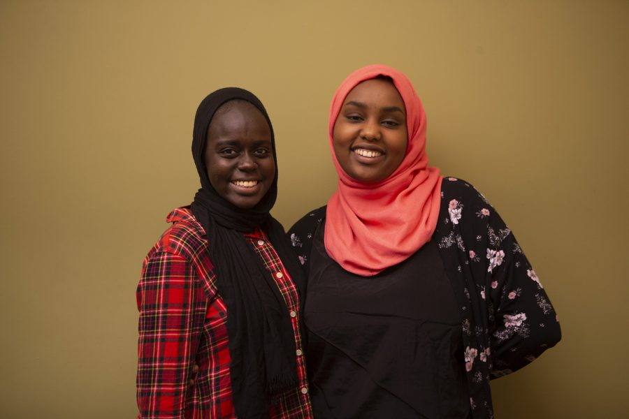 Amani Ali (left) and Salma AshShareef (right) pose for a portrait in the Iowa City Public Library on July 18, 2019. (Emily Wangen/The Daily Iowan)