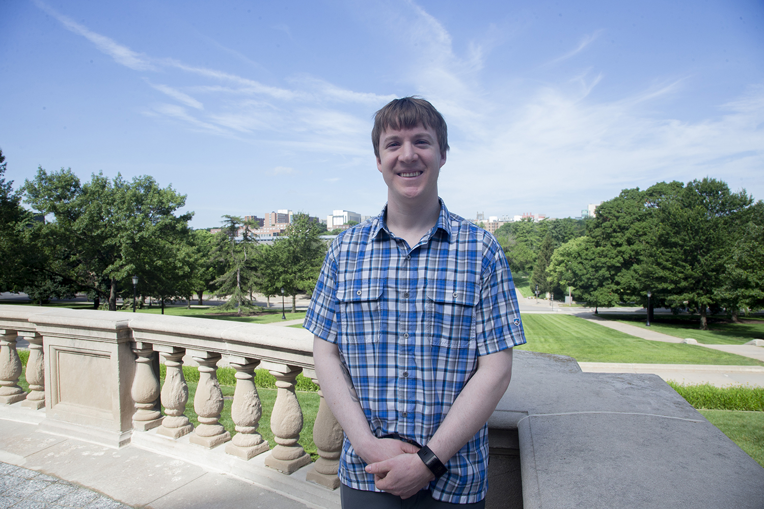 Fullbright scholar Erik Ovrom poses for a portrait outside the Old Capitol building on Thursday, July 4, 2019. Ovrom will be teaching English in Mexico City. (Emily Wangen/The Daily Iowan)