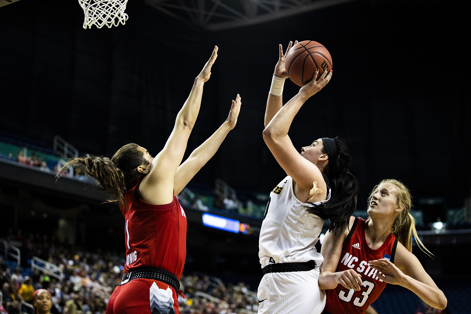Iowa center Megan Gustafson shoots the ball during the NCAA Sweet 16 game against NC State at the Greensboro Coliseum Complex on Saturday, March 30, 2019. The Hawkeyes defeated the Wolfpack 79-61.