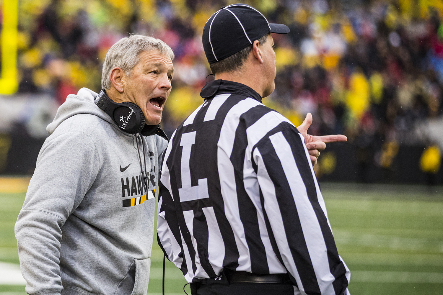 Iowa head coach Kirk Ferentz discusses the fine points of officiating with the line judge during Iowa's game against Nebraska at Kinnick Stadium in Iowa City on Friday, November 23, 2018. The Hawkeyes defeated the Huskers 31-28.