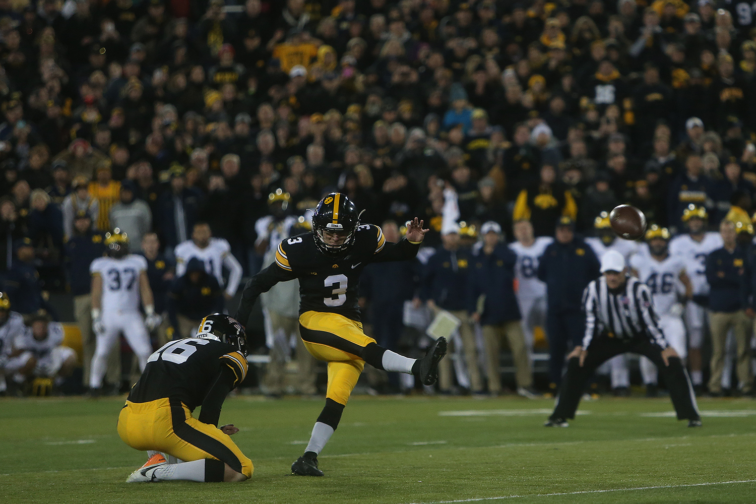 Iowa kicker Keith Duncan kicks the game winning field goal with no seconds left of the Iowa-Michigan game at Kinnick on Saturday, Nov. 12, 2016. The Hawkeyes defeated No. 2 Michigan by a 33-yard field goal with no time left to win, 14-13. (The Daily Iowan/Margaret Kispert)