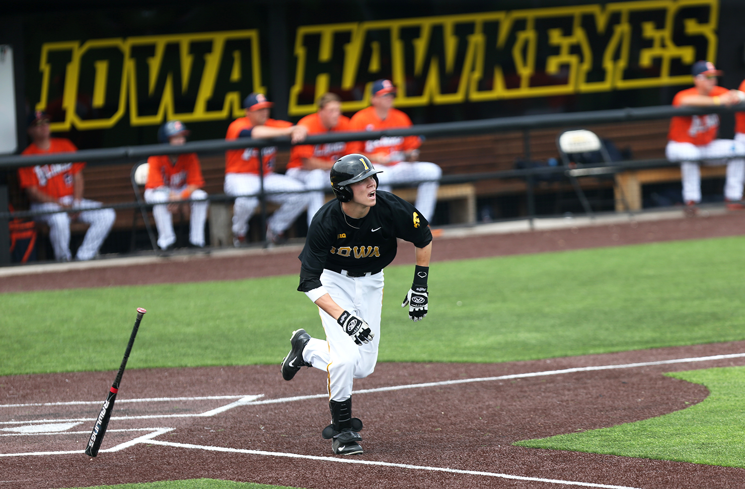 Iowa infielder Jake Yacinich runs to first base in Duane Banks Field on Saturday, May 10, 2014. The Fighting Illini defeated the Hawkeyes in the second game, 5-1. (The Daily Iowan/Allison Orvis)