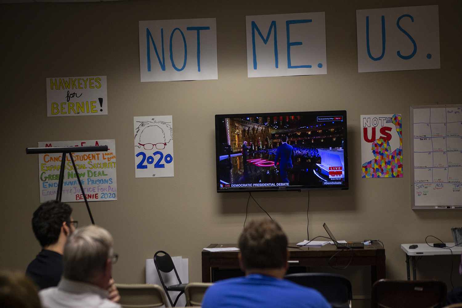 Supporters of Senator Bernie Sanders, D-VT, watch the debates from his campaign office in Iowa City on July 30, 2019. (Katie Goodale/The Daily Iowan)