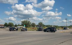 Iowa City police respond to the scene where an officer-involved shooting reportedly occurred near 11 Highway West on July 29, 2019.