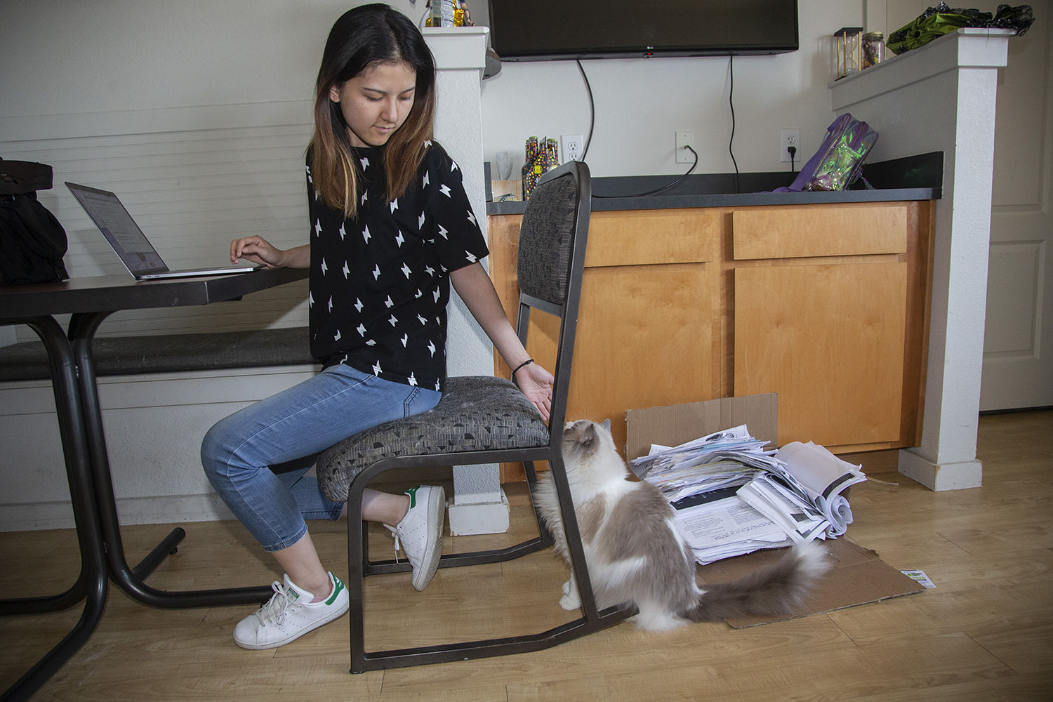 International student Yao Wang sits in her apartment in Hawks Ridge on July 8, 2019. Wang is studying Computer Science and is in her final semester. (Katie Goodale/The Daily Iowan)
