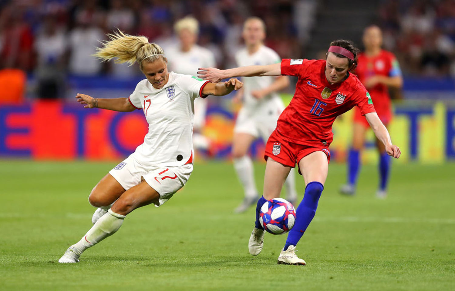 Rachel Daly of England battles for possession with Rose Lavelle of the USA during the 2019 FIFA Women's World Cup France Semi Final match between England and USA at Stade de Lyon on July 02, 2019 in Lyon, France. (Richard Heathcote/Getty Images/TNS)
