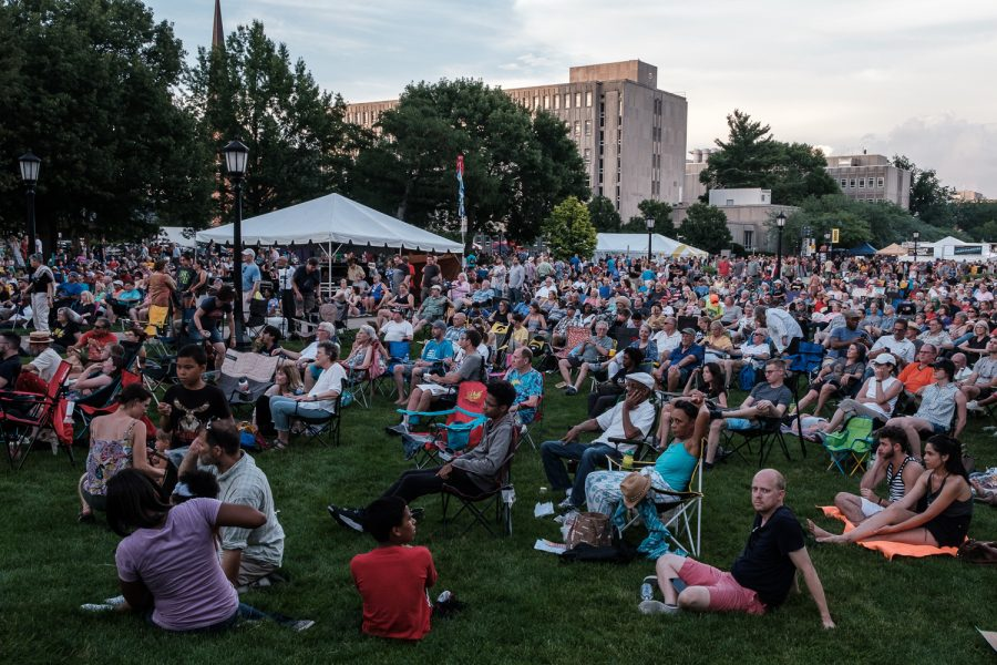 The audience watches a performance during the 2019 Iowa City Jazz Festival in downtown Iowa City on Friday, July 5, 2019.  Jazz Fest is a three day extravaganza with stages on Iowa Avenue, Clinton Street, and the Pentacrest. The last performance will commence at 9 p.m. on Sunday.