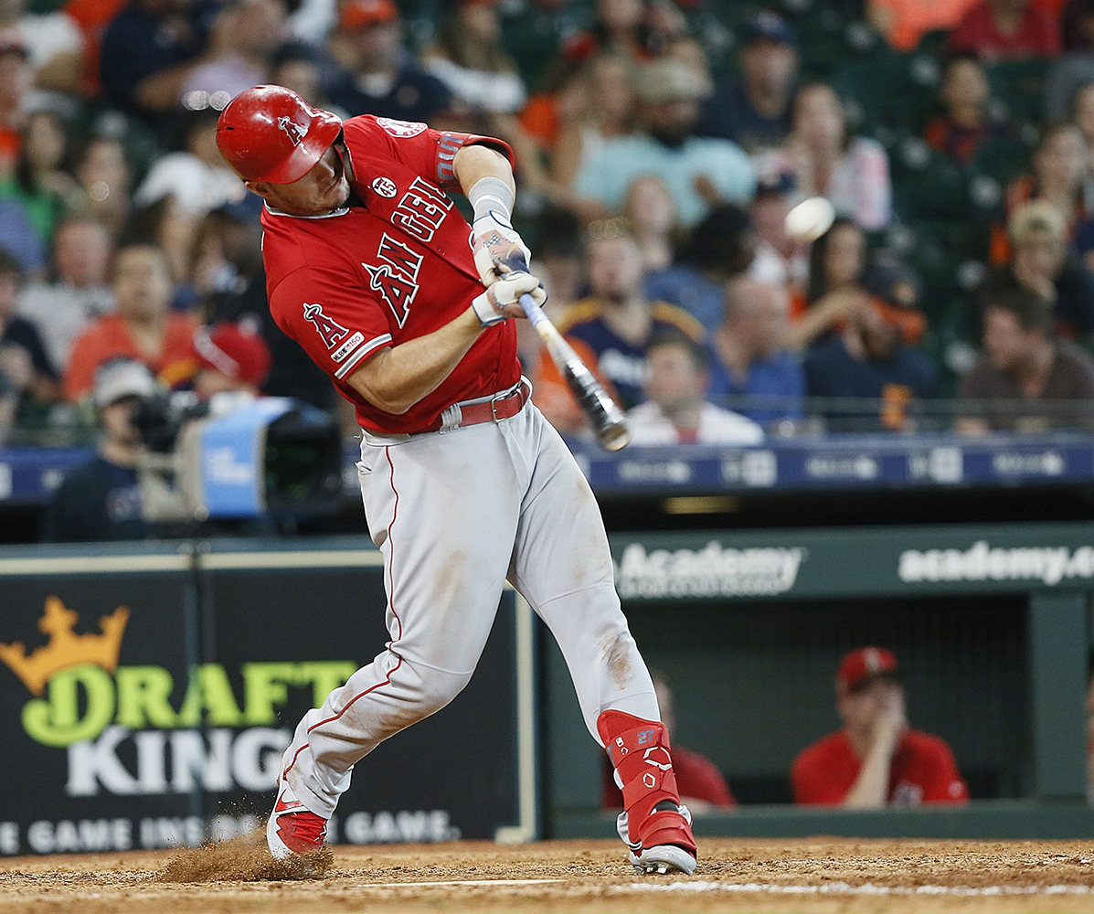 Mike Trout #27 of the Los Angeles Angels of Anaheim hits a two-run home run in the eighth inning Houston Astros at Minute Maid Park on July 07, 2019 in Houston, Texas. (Bob Levey/Getty Images/TNS)