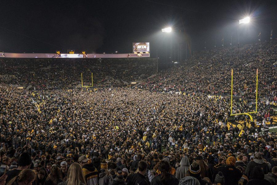 Fans rush the stadium after the Iowa vs. Ohio State game at Kinnick Stadium on Nov. 4, 2017. Iowa defeated Ohio State 55-24.