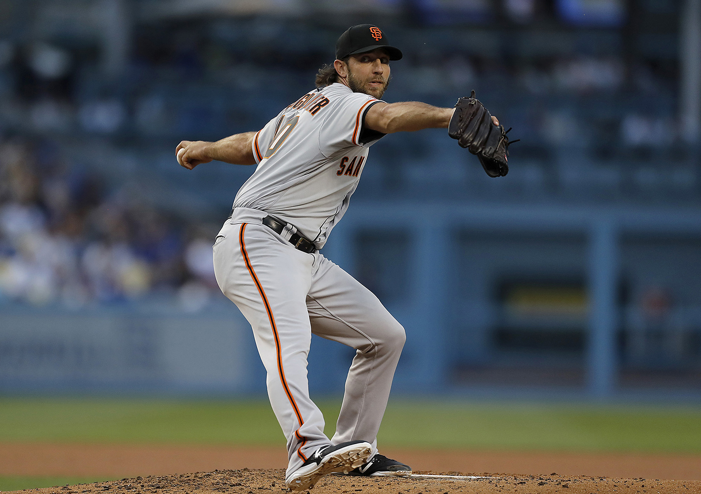 The San Francisco Giants' Madison Bumgarner delivers a pitch against the Los Angeles Dodgers in the second inning on Thursday, June 20, 2019, at Dodger Stadium in Los Angeles. (Luis Sinco/Los Angeles Times/TNS)