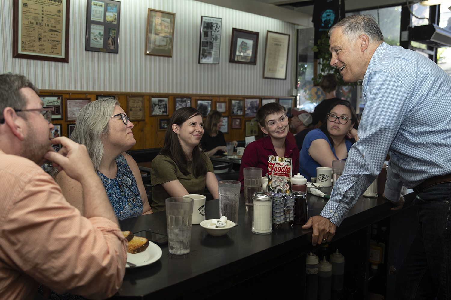 Governor of Washington Jay Inslee speaks with professors during his meeting with several non-tenured faculty members at the Hamburg Inn in Iowa City on July 15, 2019. Faculty members spoke with Inslee about some of the concerns they have regarding pay and job security. (Katie Goodale/The Daily Iowan)