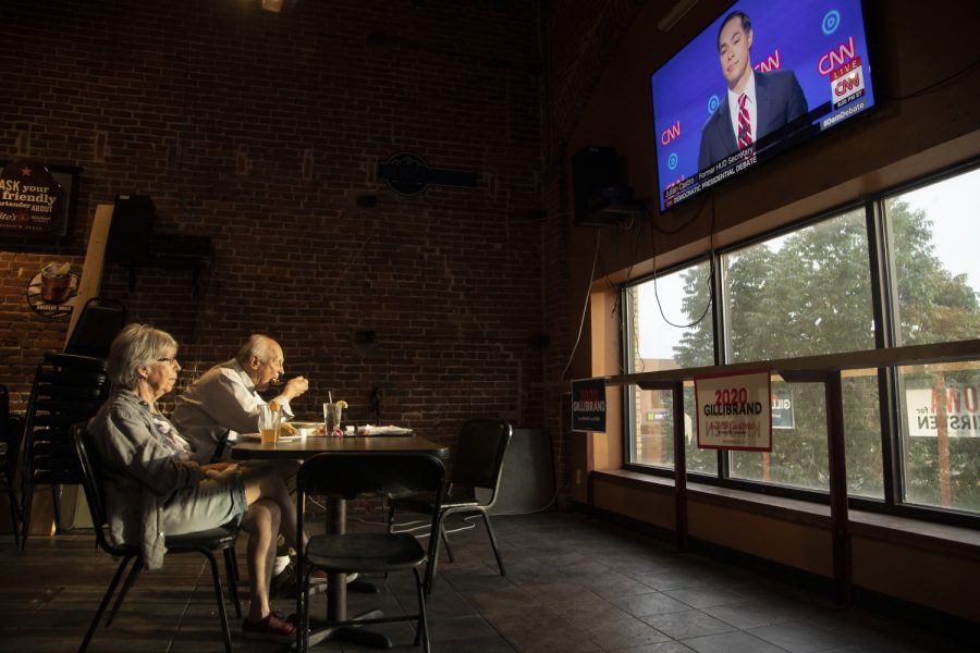 Nicholas Johnson and Mary Vasey of Iowa City watch the debate at Airliner for Sen. Kirsten Gillibrand on July 31, 2019. This is the second night of the second round of debates for democratic candidates. (Ryan Adams/The Daily Iowan)