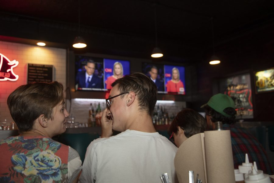 Attendees converse during a debate watch party for Sen. Cory Booker at Mosley's on July 31, 2019. This is the second night of the second round of debates for democratic candidates. (Ryan Adams/The Daily Iowan)