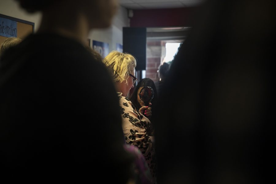 An+attendee+holds+a+fan%2C+waiting+for+the+arrival+of+Former+Vice+President+and+2020+democratic+candidate+Joe+Biden+at+the+opening+of+his+campaign+office+on+S.+Gilbert+St.+on+Wednesday%2C+August+7%2C+2019.+